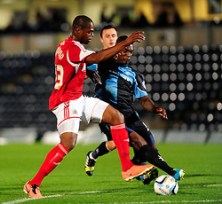 Bristol City's Marlon Harewood is tackled by Wycombe Wanderers' Anthony Stewart - Photo mandatory by-line: Joe Dent/JMP - Tel: Mobile: 07966 386802 08/10/2013 - SPORT - FOOTBALL - London Road Stadium - Peterborough - Peterborough United V Brentford - Johnstone Paint Trophy