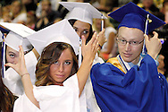 Students turn their tassels during the 119th annual Springboro High School commencement at the Nutter Center in Fairborn, Saturday, June 2, 2012.