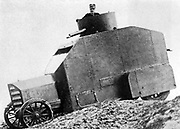 Italian armoured personnel carrier fitted with a gun turret on the roof, c1914.  The armour has been constructed round a production car.