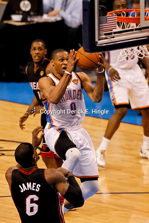 Jun 14, 2012; Oklahoma City, OK, USA; Oklahoma City Thunder point guard Russell Westbrook (0) shoots over Miami Heat small forward LeBron James (6) during the third quarter of game two in the 2012 NBA Finals at Chesapeake Energy Arena. Mandatory Credit: Derick E. Hingle-US PRESSWIRE