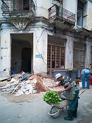 Old Havana, Cuba. Havana vieja, street. Man with cart, vegetables. Construction work.
