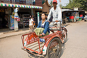 26 FEBRUARY 2008 -- MYAWADDY, MYANMAR: A rickshaw taxi in Myawaddy, Myanmar. Myawaddy is just across the Moei River from Mae Sot, Thailand and is one of Myanmar's leading land ports for goods going to and coming from Thailand. Most of the businesses in the town are geared towards trade, both legal and illegal, with Thailand. Human rights activists from Myanmar maintain that the Burmese government controls the drug smuggling trade between the two countries and that most illegal drugs made in Myanmar are shipped into Thailand from Myawaddy.   Photo by Jack Kurtz