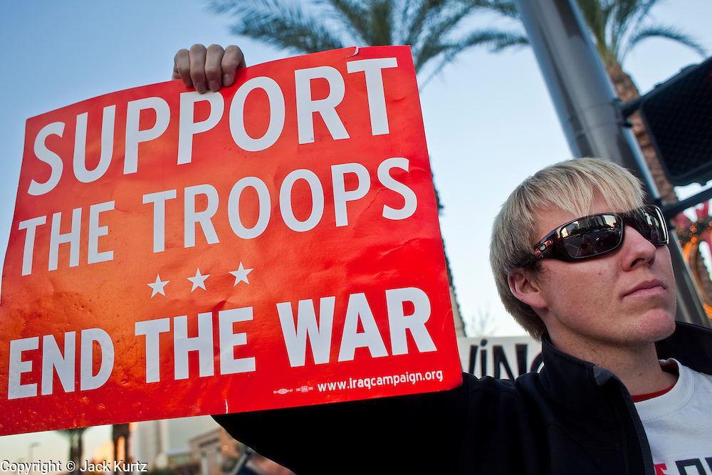 Dec. 2, 2009 -- PHOENIX, AZ: ANDY ODENDAHL, from Fountain Hills, AZ, protests the US troop increase in Afghanistan on a street corner in Phoenix Wednesday. About 50 people from across the Phoenix metropolitan area attended the protest and vigil against the troop increase President Barack Obama announced on Dec. 1. Photo by Jack Kurtz