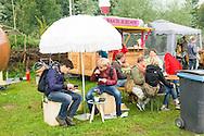Nederland, Den Bosch, 20140830 <br /> Lekker eten van de wagen van de Bakblikbende.<br /> Effect Festival - 30 Augustus 2014, De Gemeint 3, bij het Engelermeer tussen Vlijmen en Den Bosch.<br /> eFFect is een manifestatie van lokale duurzame initiatieven die burgers samen van onderop in het leven zetten. Een marktplaats, maar ook workshops door kunstenaars en muziek optredens. Daarnaast ook veel gezonde en alternatieve eettentjes.<br /> <br /> Netherlands, Den Bosch, 20140830.