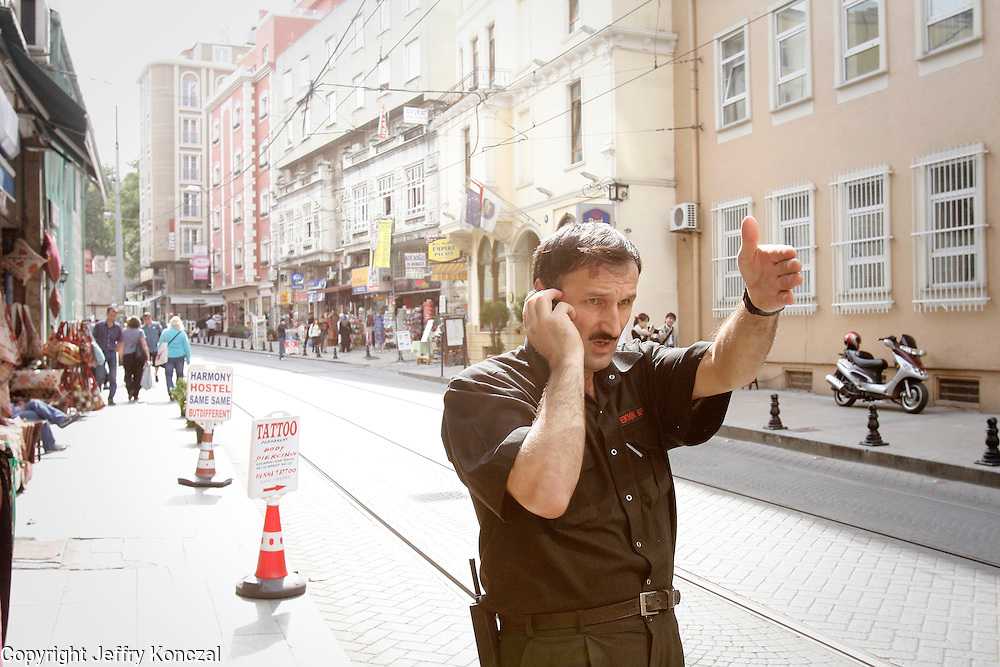 A man motions with his arm while on the phone in Istanbul, Turkey.
