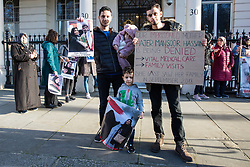 London, UK. 14th February, 2019. Sayed Ahmed Alwadaei (l) stands outside the Bahrain Embassy with activists from the Bahrain Institute for Rights and Democracy (BIRD) and Campaign Against the Arms Trade (CAAT) to mark eight years since the Day of Rage in Bahrain, a movement for democracy and social justice which was crushed by the Bahraini regime with support from the military of Saudi Arabia. Speakers called for the release of political prisoners held in Bahrain and for the UK to stop licensing arms to Bahrain (over £100 million in licences have been granted since the uprising began in February 2011). Alwadaei was granted asylum in the UK in 2012 after being given a six-month sentence by the Bahrain government for his involvement in Arab Spring protests. Bahrain was recently found guilty by a UN body of arbitrarily detaining three of his relatives after he protested in London against a 2017 visit by the King of Bahrain Hamad bin Isa Al Khalifa.