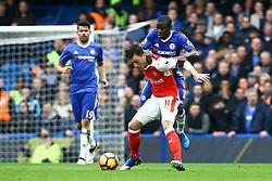 Ngolo Kante of Chelsea tackles Mesut Ozil of Arsenal - Mandatory by-line: Jason Brown/JMP - 04/01/2017 - FOOTBALL - Stamford Bridge - London, England - Chelsea v Arsenal - Premier League