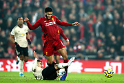 Manchester United midfielder Andreas Pereira (15) slide tackles Liverpool defender Joe Gomez (12) during the Premier League match between Liverpool and Manchester United at Anfield, Liverpool, England on 19 January 2020.