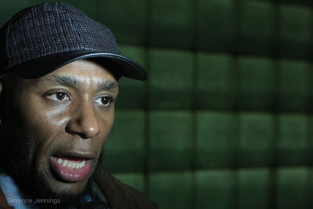 May 1, 2012- New York, United States- Recording Artist/Actor Yasiin Bey (Formely known as Mos Def) reads a Poem while he attends Occupy Wall Street May Day Celebration with March/Parade down Broadway in New York City with calls for General Strike-with No Work-No Housework-No shopping-No School. Occupy Wall Street is a leaderless resistance movement with people of many colors, genders and political persuasions. Their belief holds that one thing we all have in common is that We Are The 99% that will no longer tolerate the greed and corruption of the 1%. We are using the revolutionary Arab Spring tactic to achieve our ends and encourage the use of nonviolence to maximize the safety of all participants.((Photo by Terrence Jennings).