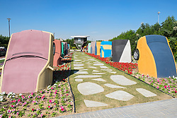 View of flower displays with model car sculptures at  Miracle Garden the world's biggest flower garden in Dubai United Arab Emirates