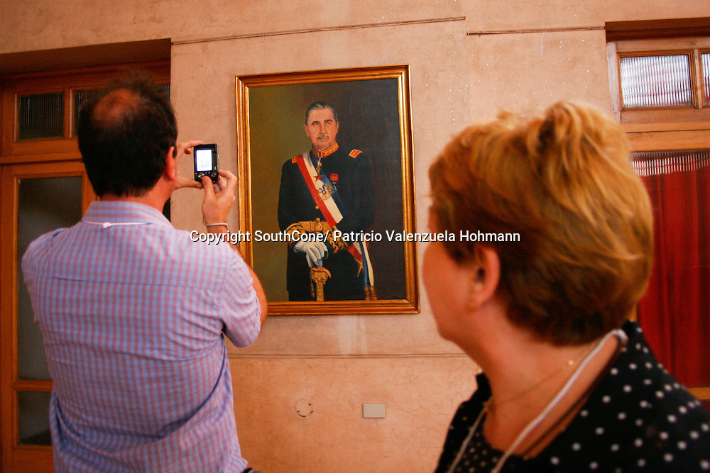Supporters picture a painting of the dictator.<br /> December 2006, The Chilean Dictator Augusto Pinochet died in Santiago Chile. As news spread thousands went out the streets either to celebrate o mourn Pinochet who lead the 1973 coup that overthrew the democratically elected president Salvador Allende. Pinochet's 17 year regime killed and disappeared around 4.000 people, tortured and exile around 20.000. On 1989 he lost elections and democracy was regained. He died on late December 2006. December 2006, The Chilean Dictator Augusto Pinochet died in Santiago Chile. As news spread thousands went out the streets either to celebrate o mourn Pinochet who lead the 1973 coup that overthrew the democratically elected president Salvador Allende. Pinochet's 17 year December 2006, The Chilean Dictator Augusto Pinochet died in Santiago Chile. As news spread thousands went out the streets either to celebrate o mourn Pinochet who lead the 1973 coup that overthrew the democratically elected president Salvador Allende. Pinochet's 17 year.