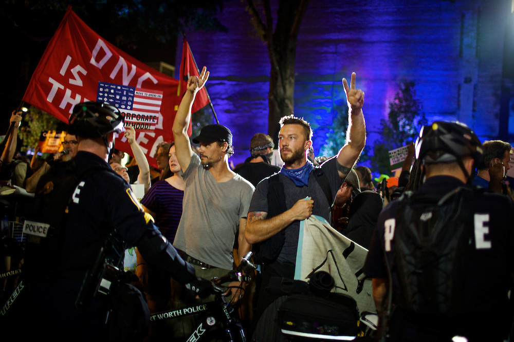 Members of the Occupy Wall Street movement are blocked by police in Charlotte, N.C. while they protest during the 2012 Democratic National Convention on Sept. 6, 2012.