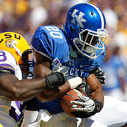 October 1, 2011; Baton Rouge, LA, USA;  LSU Tigers defensive tackle Bennie Logan (93) tackles Kentucky Wildcats running back Josh Clemons (20) during the first quarter at Tiger Stadium.  Mandatory Credit: Derick E. Hingle-US PRESSWIRE / © Derick E. Hingle 2011