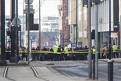 © Licensed to London News Pictures . 08/02/2013 . Manchester , UK . Police have carried out a controlled explosion on a suspicious package in Manchester City Centre this morning (8th February). The city is closed to all traffic and pedestrians , buildings have been evacuated and a cordon placed around Piccadilly Gardens and blocks around it as Explosive Ordinance Experts examine a suspect package . Photo credit : Joel Goodman/LNP