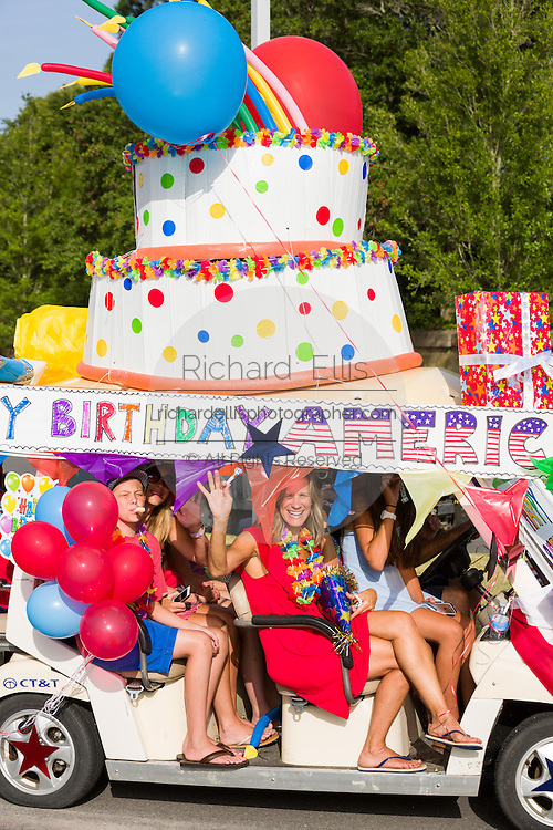 A golf cart decorated as a giant birthday cake during the Sullivan's Island Independence Day parade July 4, 2015 in Sullivan's Island, South Carolina.