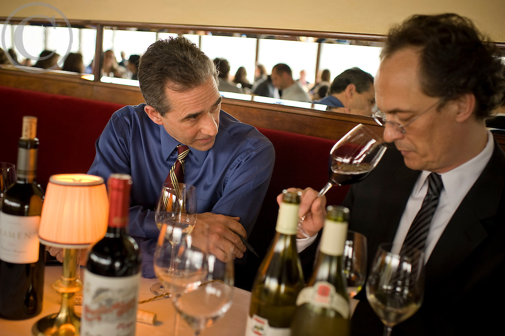 Patrick Goupit, Maître d' hôtel, at The River Café is also pictured..New York, NY - Wed, Mar 21, 2012:  Joseph DeLissio (blue shirt), Wine Director of The River Café at 1 Water Street in Brooklyn, NY. Credit: Rob Bennett for The Wall Street Journal Slug: NYUNCORK
