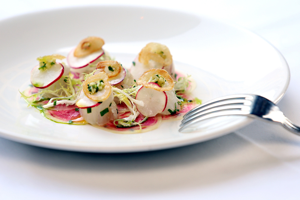 Marinated fluke crude with watermelon radish, ginger and crispy onion. Outside dining at the Clam, 420 Hudson Street, Monday, April 6, 2015. The restaurant features an outdoor oyster happy hour from 4:00 to 6:00pm. (Alexander Cohn for New York Daily News)
