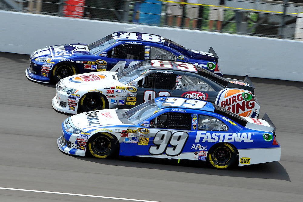 Brooklyn, MI - JUN 17, 2012: Jimmie Johnson (48),Landon Cassill (83) and Carl Edwards (99) go three wide during race action for the Quicken Loans 400 race at the Michigan International Speedway in Brooklyn, MI.