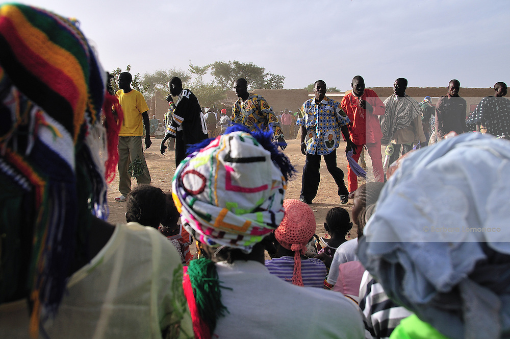 The men dance and parade facing the women attending the festival