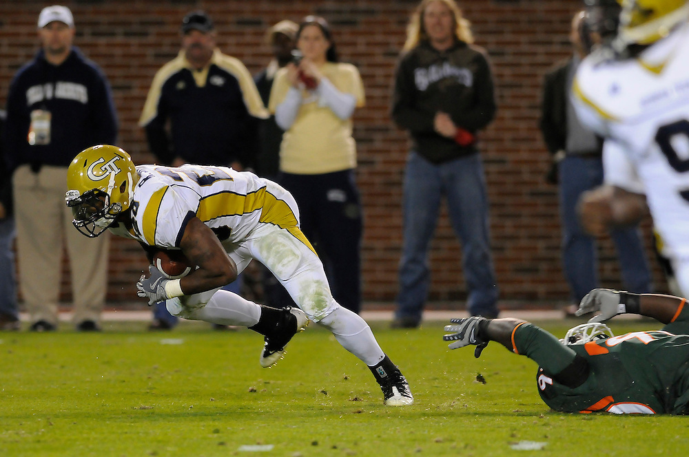 November 20, 2008: Roddy Jones of the Georgia Tech Yellow Jackets runs through the attempted tackle by Dwayne Hendricks of the Miami Hurricanes during the NCAA football game between the Miami Hurricanes and the Georgia Tech Yellow Jackets. The Yellow Jackets defeated the Hurricanes 41-23.