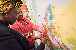 20 February 2019, Geneva, Switzerland: People use pins on a map to indicate their trajectory as migrants around the globe. On 20-21 February, PEPFAR, UNAIDS, the World Council of Churches and the International Catholic Migration Commission host a workshop on HIV among migrants and refugees. The aim of the workshop is to identify a roadmap for strengthening faith-based organizations' engagement in collaboration with other sectors, expanding the role of faith-based organizations in addressing HIV risk and providing services to migrants and refugees.