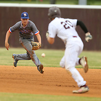 North Pontotoc's second basemen Hence Hooper chases down a ground ball as Houston runner Luke Hancock makes his move to second.