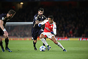 Arsenal striker Alexis Sanchez shielding the ball during the Champions League match between Arsenal and Dinamo Zagreb at the Emirates Stadium, London, England on 24 November 2015. Photo by Matthew Redman.