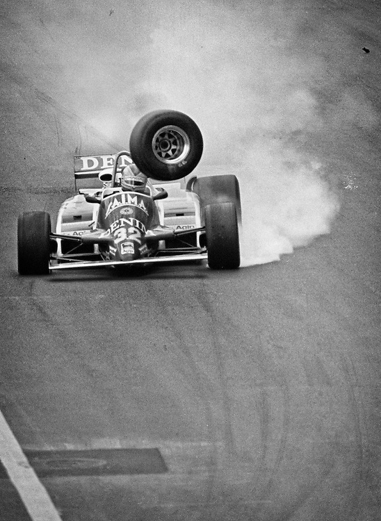 Formula 1 Rookie Riccardo Paletti in trouble when his Osella's right drive shaft broke over a bump during the 1982 Detroit Grand Prix. The car was destroyed, but he would walk away unscathed. Tragically, he would be killed a week later at the start of the Canada Grand Prix. Launching his car from the last row, he would hit the rear of the stationary Ferrari of Didier Pironi stalled on the grid and succumb to his injuries. He was never able to complete a single full grid Grand Prix race lap.