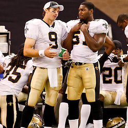 August 21, 2010; New Orleans, LA, USA; New Orleans Saints quarterback Drew Brees (9) and linebacker Jonathan Vilma (51) talk on the sideline during the second half of a 38-20 win by the New Orleans Saints over the Houston Texans during a preseason game at the Louisiana Superdome. Mandatory Credit: Derick E. Hingle