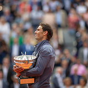 PARIS, FRANCE June 09.   Rafael Nadal of Spain holds the winners trophy during the winners National Anthem after his victory against Dominic Thiem of Austria during the Men's Singles Final on Court Philippe-Chatrier at the 2019 French Open Tennis Tournament at Roland Garros on June 9th 2019 in Paris, France. (Photo by Tim Clayton/Corbis via Getty Images)
