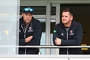 Marcus Trescothick of Somerset and Steve Davies of Somerset on the team balcony as play is abandoned for the day due to a wet outfield after heavy overnight rain during the Specsavers County Champ Div 1 match between Somerset County Cricket Club and Essex County Cricket Club at the Cooper Associates County Ground, Taunton, United Kingdom on 25 September 2019.