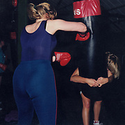 Woman punching a punchbag in the gym
