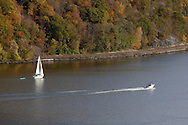 Fort Montgomery, NY - A motorboat and a sailboat head south on the Hudson River near the Bear Mountain Bridge on Nov. 2, 2008.