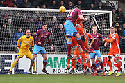 Scunthorpe United defender Cameron Burgess (21) heads the ball towards goal during the EFL Sky Bet League 1 match between Scunthorpe United and Shrewsbury Town at Glanford Park, Scunthorpe, England on 17 March 2018. Picture by Mick Atkins.