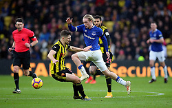 Watford's Craig Cathcart (left) and Everton's Tom Davies (right) battle for the ball during the Premier League match at Vicarage Road, Watford.