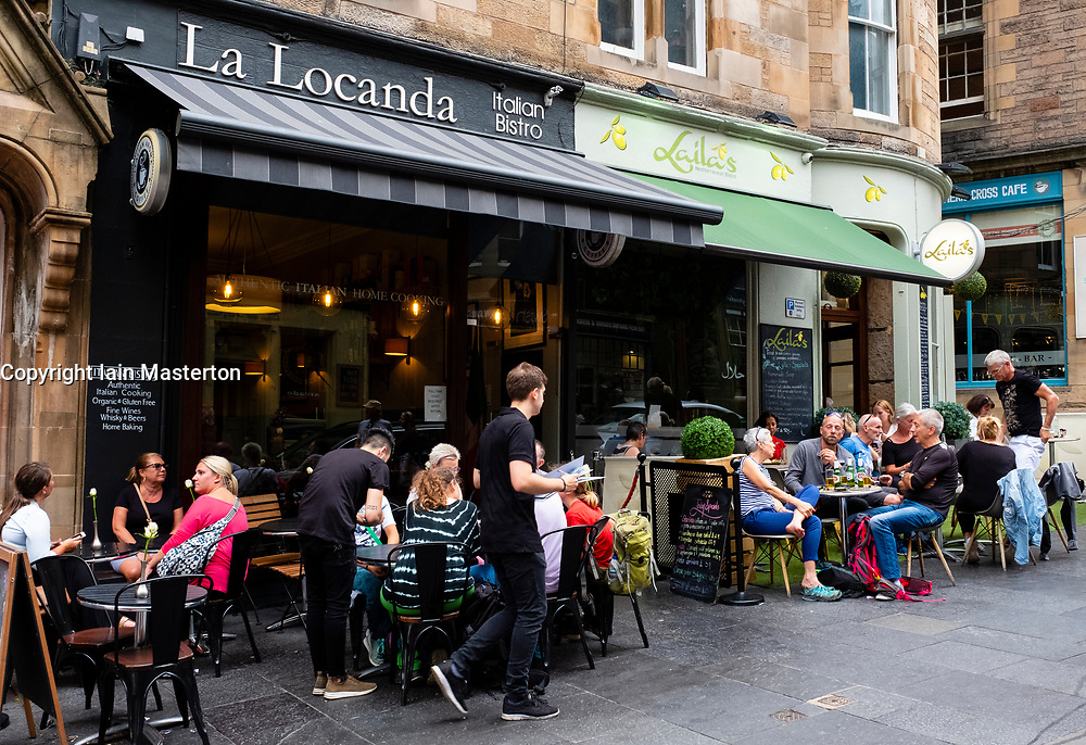 Bars and cafes in summer on Cockburn Street in the Old Town of Edinburgh, Scotland, UK