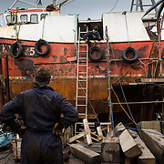 Mallaig Boatyard. Discussions over the next move .  Picture Robert Perry 9th April 2016<br /> <br /> Must credit photo to Robert Perry<br /> FEE PAYABLE FOR REPRO USE<br /> FEE PAYABLE FOR ALL INTERNET USE<br /> www.robertperry.co.uk<br /> NB -This image is not to be distributed without the prior consent of the copyright holder.<br /> in using this image you agree to abide by terms and conditions as stated in this caption.<br /> All monies payable to Robert Perry<br /> <br /> (PLEASE DO NOT REMOVE THIS CAPTION)<br /> This image is intended for Editorial use (e.g. news). Any commercial or promotional use requires additional clearance. <br /> Copyright 2014 All rights protected.<br /> first use only<br /> contact details<br /> Robert Perry     <br /> 07702 631 477<br /> robertperryphotos@gmail.com<br /> no internet usage without prior consent.         <br /> Robert Perry reserves the right to pursue unauthorised use of this image . If you violate my intellectual property you may be liable for  damages, loss of income, and profits you derive from the use of this image.