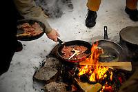 Swedish Lapland - Frying reindeer meat over an open flame - Photos from Jokkmokk, Arctic Sweden