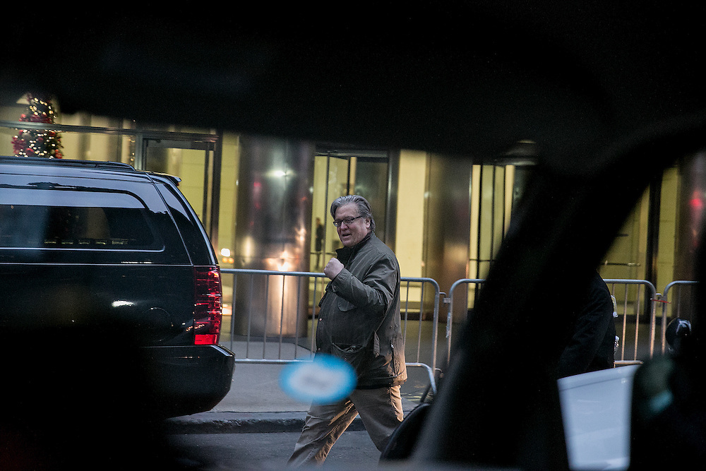 NEW YORK, NY - DECEMBER 13, 2016: Stephen Bannon, a senior strategist for President-elect Donald Trump, walks past the motorcade outside of Trump Tower in New York, New York. CREDIT: Sam Hodgson for The New York Times.