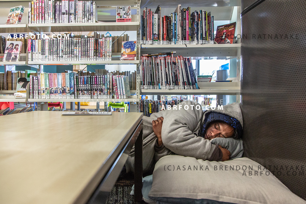 Joseph Takairangi takes a quick nap at the New Lynn War Memorial Library on the 6th of June 2018. The homeless often use the Library during the day taking advantage of the free internet and to keep out of the cold during winter. Asanka Brendon Ratnayake for The New York Times.