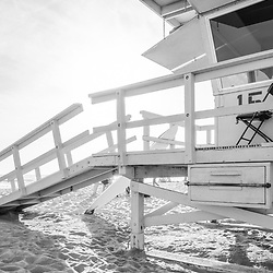 Santa Monica Lifeguard Station 15 at Santa Monica Beach in Southern California. Photo is black and white, high resolution and vertical orientation. Copyright ⓒ 2017 Paul Velgos with All Rights Reserved.