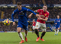 Football - 2017 / 2018 Premier League - Chelsea vs Manchester United<br /> <br /> Alvaro Morata (Chelsea FC)  and Phil Jones (Manchester United) in a race for the ball at Stamford Bridge <br /> <br /> COLORSPORT/DANIEL BEARHAM