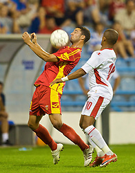 PODGORICA, MONTENEGRO - Wednesday, August 12, 2009: Wales' Robert Earnshaw and Montenegro's Radomir Dalovic during an international friendly match at the Gradski Stadion. (Photo by David Rawcliffe/Propaganda)