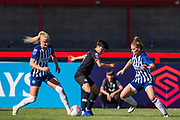 Kate Natkiel (Brighton), Ji So-Yun (Chelsea) with Fliss Gibbons (Brighton) during the FA Women's Super League match between Brighton and Hove Albion Women and Chelsea at The People's Pension Stadium, Crawley, England on 15 September 2019.