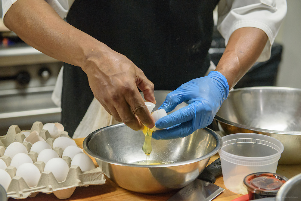 """Chef """"Super"""" Mario Smith breaks eggs before opening for lunch at anoosh Bistro. Photos at Anoosh Shariat's anoosh Bistro and Noosh Nosh Monday, Aug. 15, 2016. (Photo by Brian Bohannon)"""
