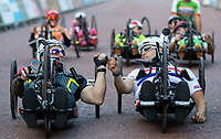 Two riders fist pump at the start line ahead of cycling up The Mall in The Prudential RideLondon Handcycle Grand Prix. Saturday 28th July 2018<br /> <br /> Photo: Ian Walton for Prudential RideLondon<br /> <br /> Prudential RideLondon is the world's greatest festival of cycling, involving 100,000+ cyclists - from Olympic champions to a free family fun ride - riding in events over closed roads in London and Surrey over the weekend of 28th and 29th July 2018<br /> <br /> See www.PrudentialRideLondon.co.uk for more.<br /> <br /> For further information: media@londonmarathonevents.co.uk