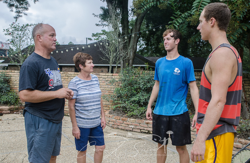 Darrell and Zanie Whitehead talk with their sons, John and Jacob Whitehead, Sept. 4, 2016, in Denham Springs, Louisiana. John Whitehead, third from left, used his kayak to rescue many of his neighbors after heavy rain caused extended flooding in mid-August. The boys attend Louisiana State University, and the family attends Istrouma Baptist Church in Baton Rouge. (Photo by Carmen K. Sisson)