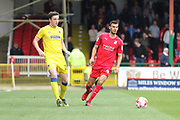 AFC Wimbledon defender Sean Kelly (22) and Swindon Town midfielder Conor Thomas (4) during the EFL Sky Bet League 1 match between Swindon Town and AFC Wimbledon at the County Ground, Swindon, England on 14 April 2017. Photo by Stuart Butcher.