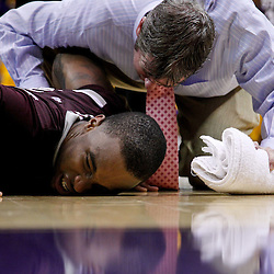 February 14, 2012; Baton Rouge, LA; Mississippi State Bulldogs forward Arnett Moultrie (23) is tended to by a trainer after an on court collision during the second half of a game against the LSU Tigers at the Pete Maravich Assembly Center. LSU defeated Mississippi State in overtime 69-67. Mandatory Credit: Derick E. Hingle-US PRESSWIRE