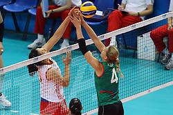China Xu Yunli and Azerbaijan Oksana Kurt fight over the net